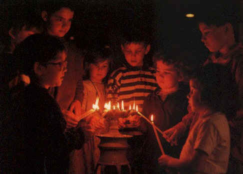 Evening in taizé, an echo of the easter vigil takes place... children